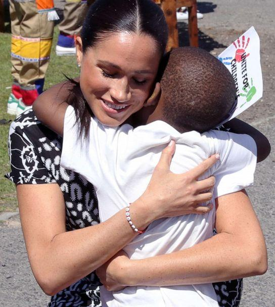 PHOTO: Meghan, Duchess of Sussex receives a hug from a young boy during a visit at a Justice Desk initiative in Nyanga township, with Prince Harry, Duke of Sussex, during their royal tour of South Africa, Sept. 23, 2019 in Cape Town, South Africa. (Chris Jackson/Getty Images)