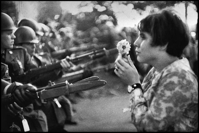 <p>An American young girl, Jan Rose Kasmir, confronts the American National Guard outside the Pentagon during the 1967 anti-Vietnam march om Washington, D.C. This march helped to turn public opinion against the U.S. war in Vietnam. (© Marc Riboud/Magnum Photos) </p>