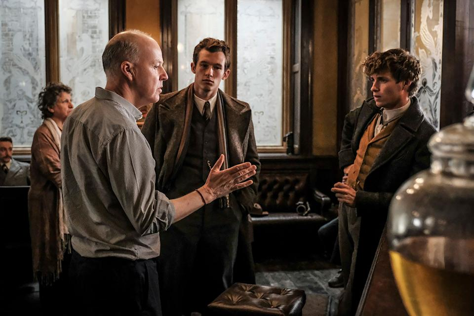(L-r) Director David Yates, Callum Turner and Eddie Redmayne on the set of Warner Bros. Pictures' fantasy adventure <i>Fantastic Beasts: The Crimes of Grindelwald</i>, a Warner Bros. Pictures release. (Photo by Jaap Buitendijk)