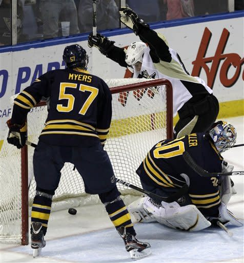 Pittsburgh Penguins' Sidney Crosby (87) celebrates his goal on Buffalo Sabres goalie Ryan Miller during the first period of an NHL hockey game in Buffalo, N.Y., Friday, March 30, 2012. The Penguins won 5-3. (AP Photo/Devin Duprey)