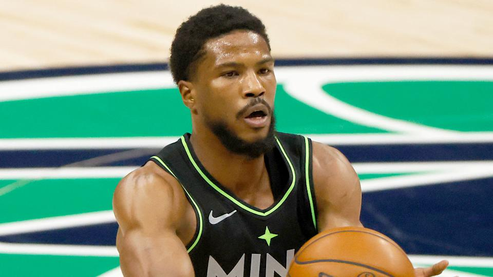 Pictured here, Malik Beasley passes the basketball during a match for the Minnesota Timberwolves.
