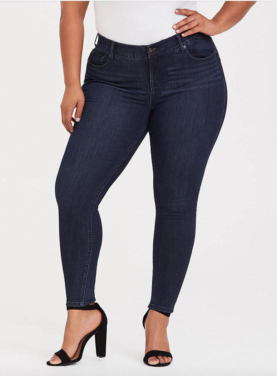 "<p><a href=""https://fave.co/2QEEzXv"" rel=""nofollow noopener"" target=""_blank"" data-ylk=""slk:Shop it:"" class=""link rapid-noclick-resp""><strong>Shop it:</strong> </a>Torrid Premium Stretch Bombshell Skinny Jean in Dark Wash, $75, <a href=""https://fave.co/2QEEzXv"" rel=""nofollow noopener"" target=""_blank"" data-ylk=""slk:torrid.com"" class=""link rapid-noclick-resp"">torrid.com</a> </p>"