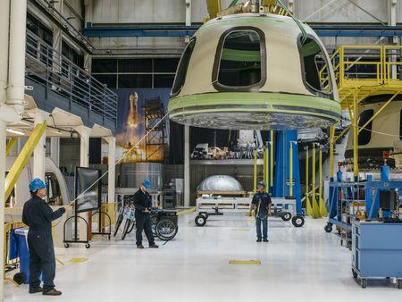Handout Blue Origin photo shows Blue Origin team members ready the New Shepard Crew Capsule during assembly in Kent, Washington