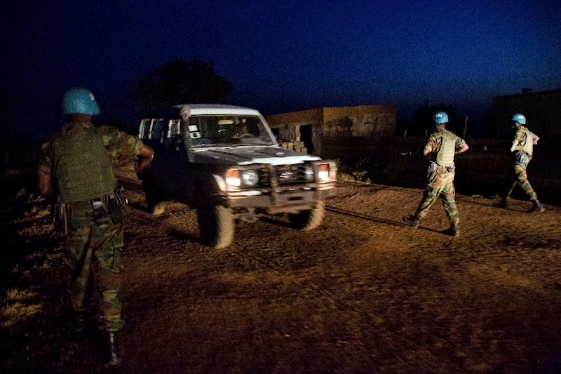 Peacekeepers from Ethiopia deployed in the United Nations Interim Security Force for Abyei patrol on December 14, 2016 (AFP Photo/Albert Gonzalez Farran)