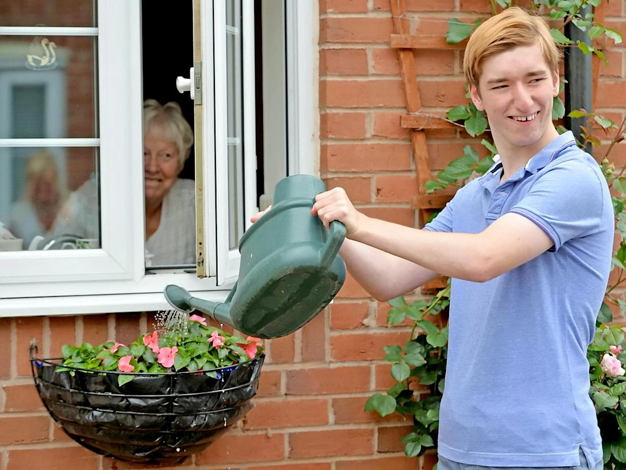 Part of his challenge involved watering neighbours garden plants. (Supplied Ashley Hall/SWNS)