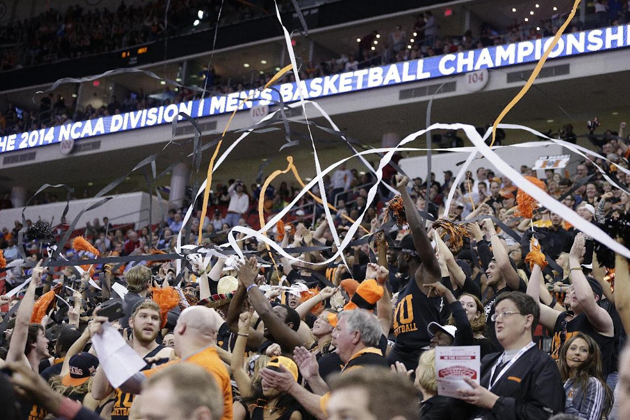 Mercer fans celebrate during the first half of an NCAA college basketball third-round tournament game against Tennessee, Sunday, March 23, 2014, in Raleigh. (AP Photo/Chuck Burton)