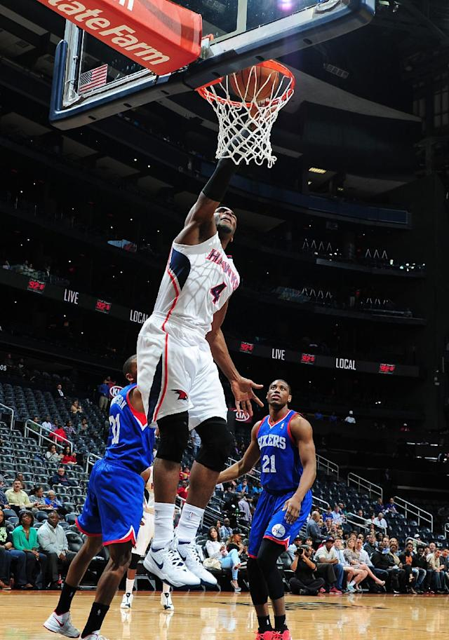 ATLANTA, GA - MARCH 31: Paul Millsap #4 of the Atlanta Hawks dunks against the Philadelphia 76ers on March 31, 2014 at Philips Arena in Atlanta, Georgia. (Photo by Scott Cunningham/NBAE via Getty Images)