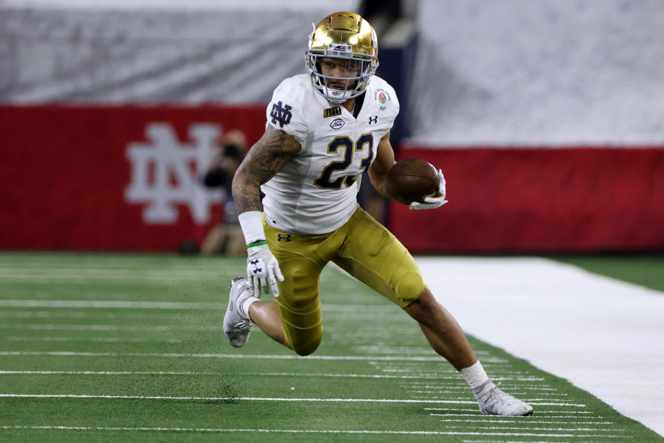 FILE - In this Jan. 1, 2021, file photo, Notre Dame running back Kyren Williams (23) runs with the ball during the Rose Bowl NCAA college football game in Arlington, Texas. Offensive coordinator Tommy Rees has seen the offense come together behind quarterback Jack Coan, a grad transfer from Wisconsin, and preseason All-American candidates in running back Kyren Williams, tight end Michael Mayer, center Jarrett Patterson and guard Cain Madden, another grad transfer. (AP Photo/Michael Ainsworth, File)
