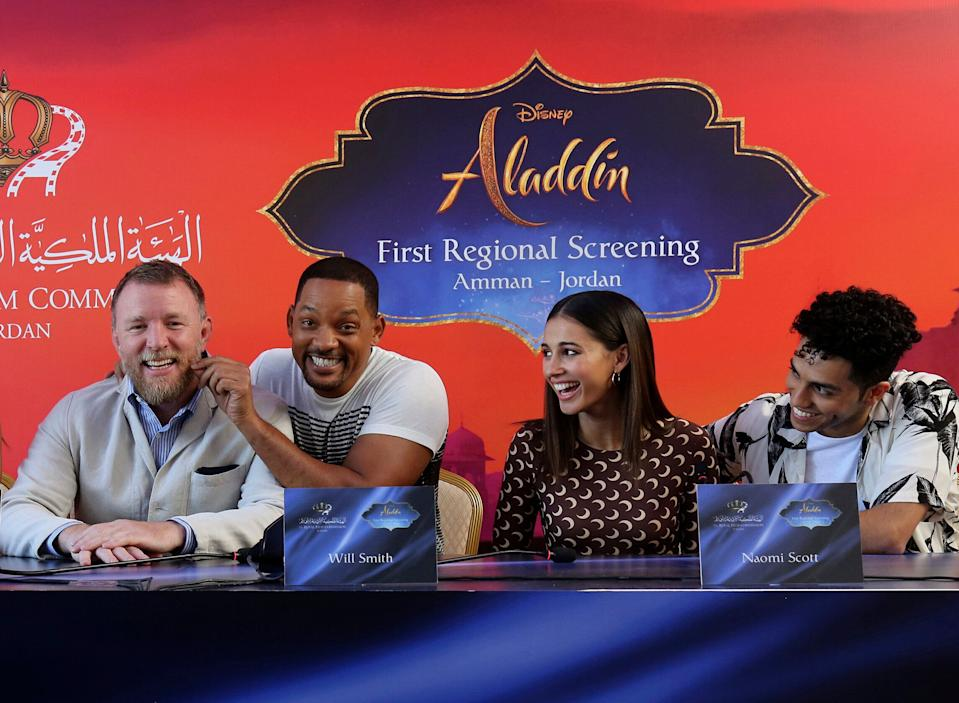 """Actor Will Smith, second right, director Guy Ritchie, left, and cast members Naomi Scott, second right, and Mena Massoud, give a news conference for the regional launching of Disney's live-action """"Aladdin,"""" in the Jordanian capital Amman, Monday, May 13, 2019. The film opens in Middle East theaters May 23. (AP Photo/Raad Adayleh)"""