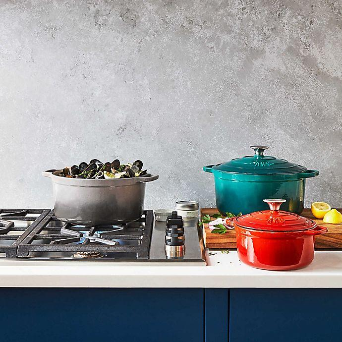 The Artisanal Kitchen Supply Enameled Cast Iron Dutch Oven is a budget-friendly choice for top-quality kitchenware. Image via Bed, Bath and Beyond.