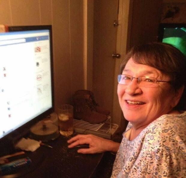 Margaret Cote on her computer. Cote remained active even after retirement. She posted language lessons and shared stories and teachings online. She continued to work on Saulteaux language projects with individual communities and organizations. (Margaret Cote/Facebook - image credit)