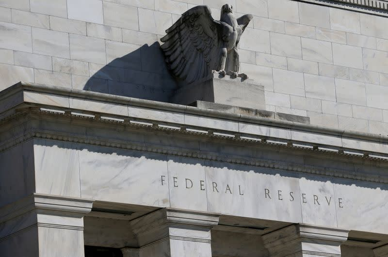 Fed policymakers vow to keep interest rates near zero, call for more fiscal help