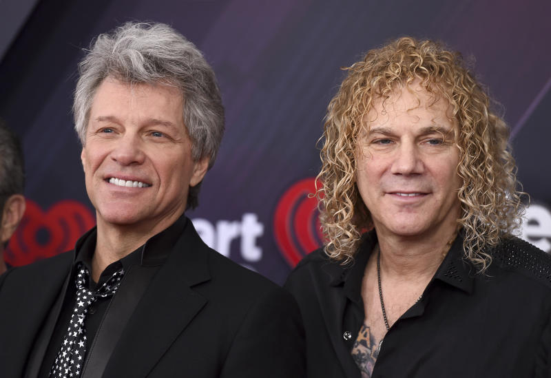 Jon Bon Jovi, left, and David Bryan, of Bon Jovi, arrive at the iHeartRadio Music Awards at The Forum on Sunday, March 11, 2018, in Inglewood, Calif. (Photo by Jordan Strauss/Invision/AP)