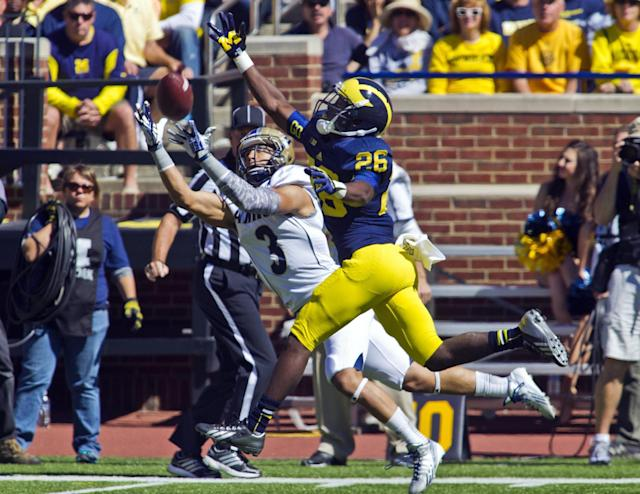 Akron wide receiver L.T. Smith (3) makes a 40-yard reception, beating Michigan defensive back Jourdan Lewis (26), in the fourth quarter of an NCAA college football game in Ann Arbor, Mich., Saturday, Sept. 14, 2013. Michigan won 28-24. (AP Photo/Tony Ding)