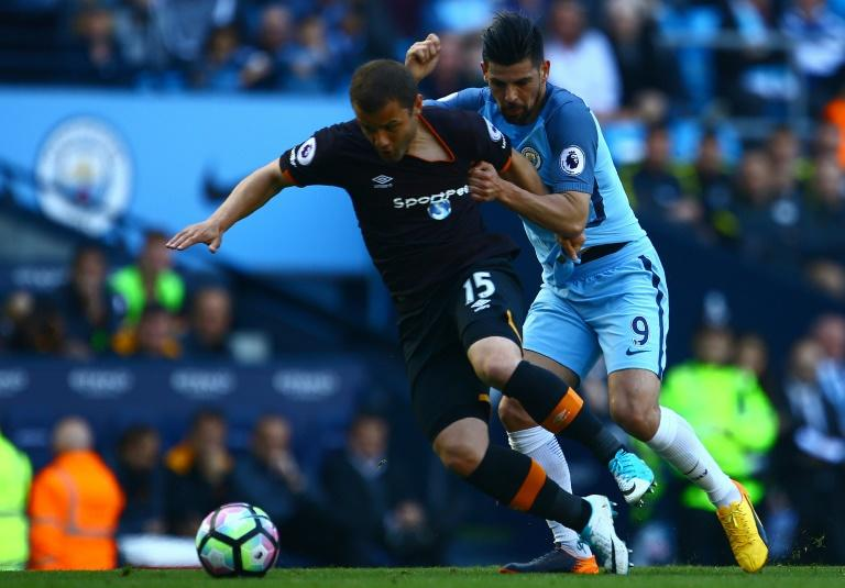 Hull City's Shaun Maloney (L) vies with Manchester City's Nolito during their match at the Etihad Stadium in Manchester, north west England, on April 8, 2017