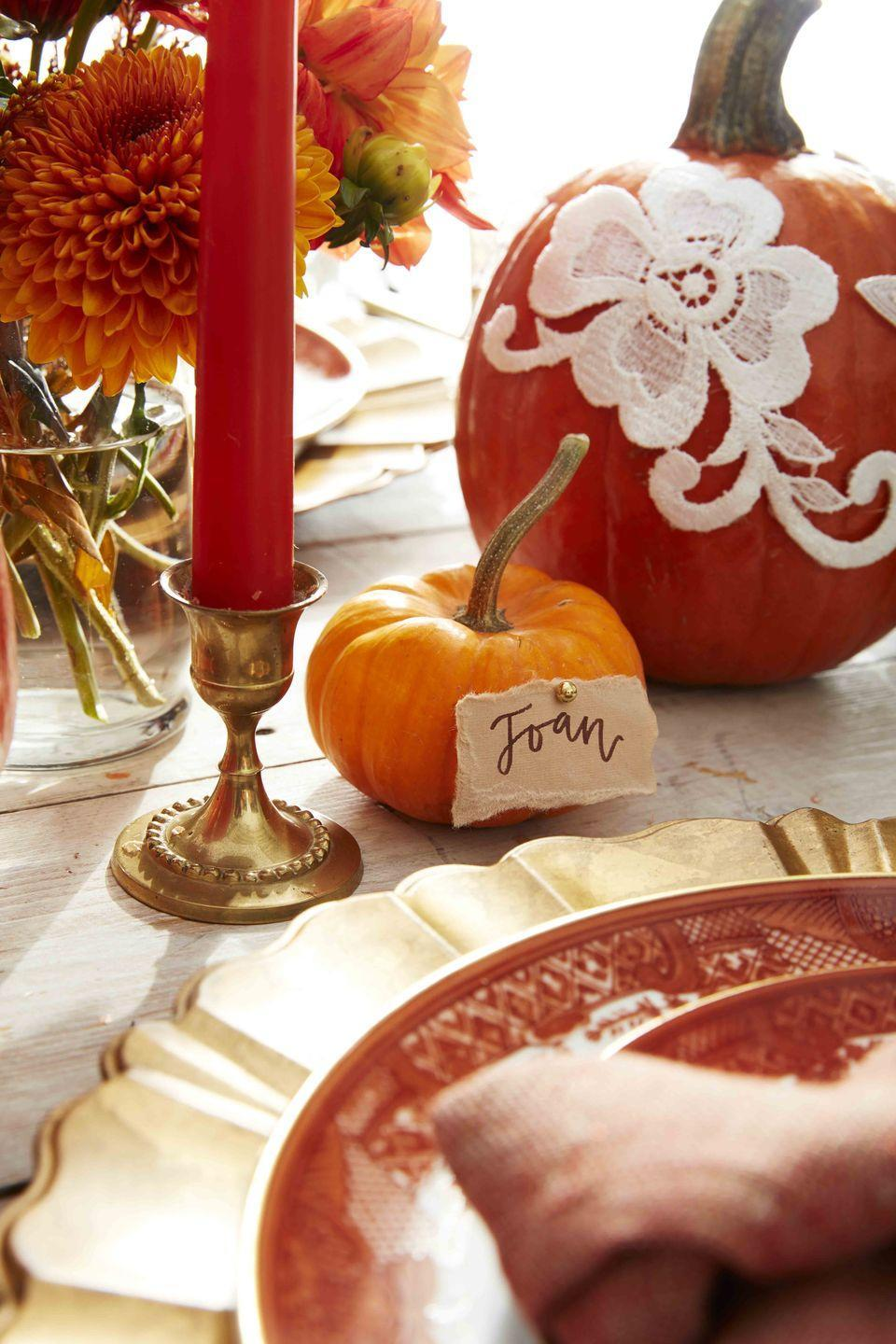<p>All it takes is a fancy gold push pin and rough torn card stock to turn the cutest mini pumpkin into your guest's place card. </p>