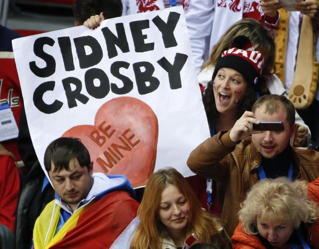A fan of team Canada holds up a Valentines Day sign for Canada forward Sidney Crosby after a men's ice hockey game against Austria at the 2014 Winter Olympics, Friday, Feb. 14, 2014, in Sochi, Russia. Canada won 6-0. (AP Photo/Julio Cortez)