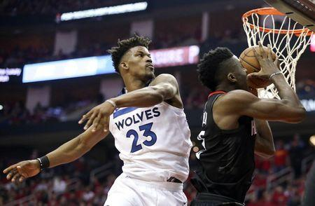 Apr 25, 2018; Houston, TX, USA; Houston Rockets center Clint Capela (15) drives past Minnesota Timberwolves guard Jimmy Butler (23) for the basket in the second half in game five of the first round of the 2018 NBA Playoffs at Toyota Center. Mandatory Credit: Thomas B. Shea-USA TODAY Sports