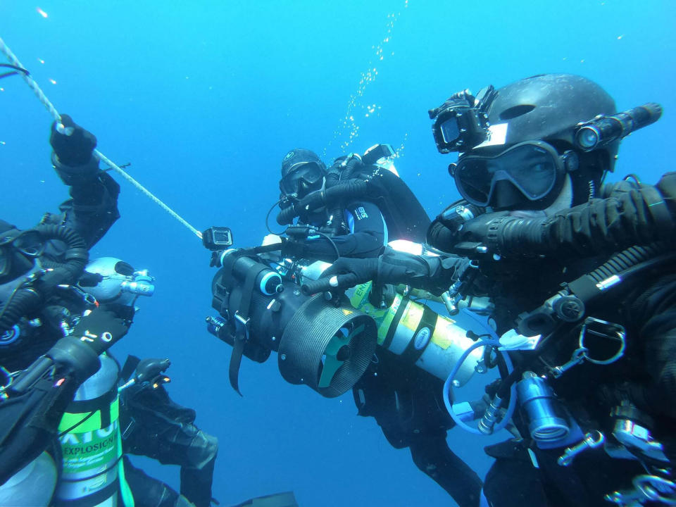 Belgian diver Ben Reymenants, right, poses for an underwater selfie photo along with Australian diver Lance Horowitz in the Strait of Malacca on Nov. 6, 2019. Divers including Reymenants have found what they believe is the wreck of a U.S. Navy submarine lost 77 years ago in Southeast Asia, providing a coda to a stirring but little-known tale from World War II. (Ben Reymenants via AP)