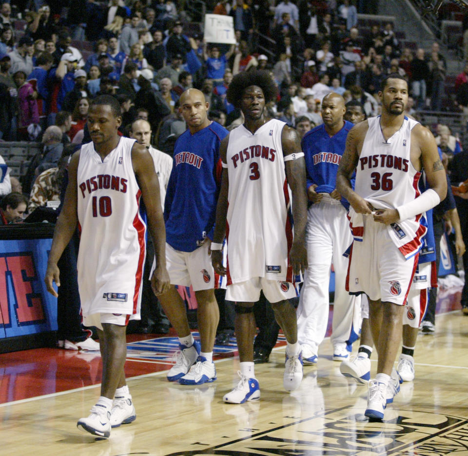 Pistons players, from left, Lindsey Hunter (10), Darvin Ham, Ben Wallace (3), Derrick Coleman and Rasheed Wallace (36) head to the locker room after their game against the Pacers was called after a serious brawl on Nov. 19, 2004, in Auburn Hills, Mich. (AP Photo/Duane Burleson)