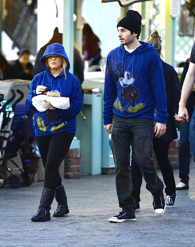 EXCLUSIVE: Christina Aguilera was spotted spending her Thanksgiving weekend at Disneyland. The 'Voice' judge was accompanied by her boyfriend Matt Rutler and her son Max. The couple wore matching Mickey Mouse sweaters. The singer munched on some snacks while walking through the park and stayed hidden and unnoticed with the help of hoodie. Pictured: Christina Aguilera, Matthew Rutler Ref: SPL463380  261112   EXCLUSIVE Picture by: Sharpshooter Images /Splash   Splash News and Pictures Los Angeles:310-821-2666 New York:212-619-2666 London:870-934-2666 photodesk@splashnews.com