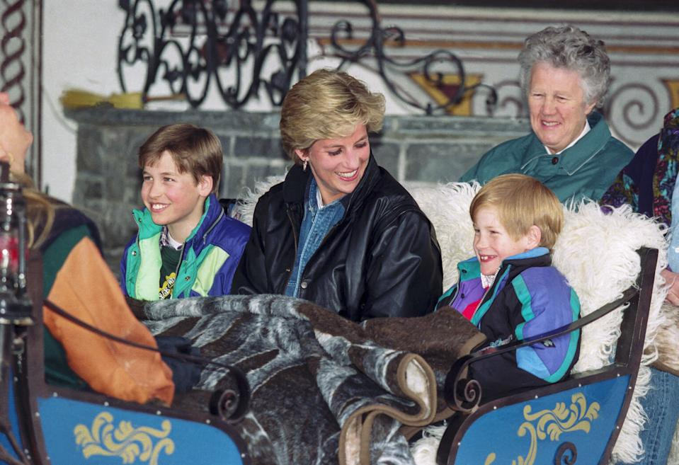 LECH,  AUSTRIA - MARCH 30:   Diana Princess of Wales with Prince William, and Prince Harry, and their Nanny Olga Powell ( right ), take an afternoon carriage ride, during their annual ski holiday, on March 30, 1993  in Lech, Austria. (Photo by Julian Parker/UK Press via Getty Images)