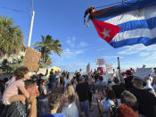 Roughly two hundred supporters of recent protests in Cuba gather at the Southernmost Point buoy in Key West, Florida, on July 13, 2021. Carrying signs demanding freedom for the Cuban people, the crowd paraded down Duval Street following an over-sized Cuban flag provided by a local tow truck company. (Rob O'Neal/The Key West Citizen via AP)