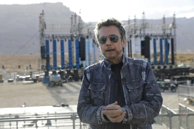 French electronic music pioneer Jean-Michel Jarre speaks during an interview as he prepares for his upcoming concert to publicise the plight of the shrinking Dead Sea at the ancient clifftop fortress of Massada, on April 2, 2017