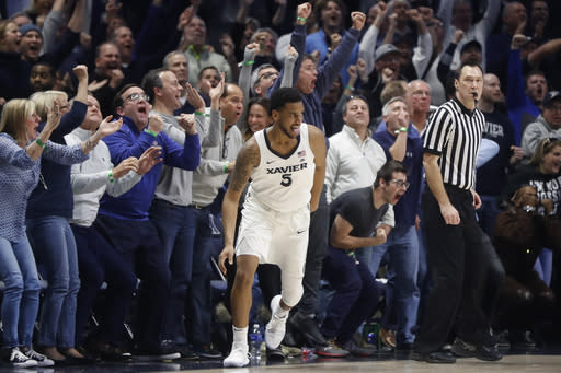 "Xavier's <a class=""link rapid-noclick-resp"" href=""/ncaab/players/126244/"" data-ylk=""slk:Trevon Bluiett"">Trevon Bluiett</a> reacts after hitting the go-ahead shot in the second half against East Tennessee State. (AP Photo)"