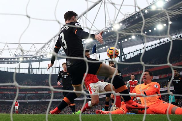 <p>Alexis Sanchez puts Arsenal ahead with his controversial handball goal</p>