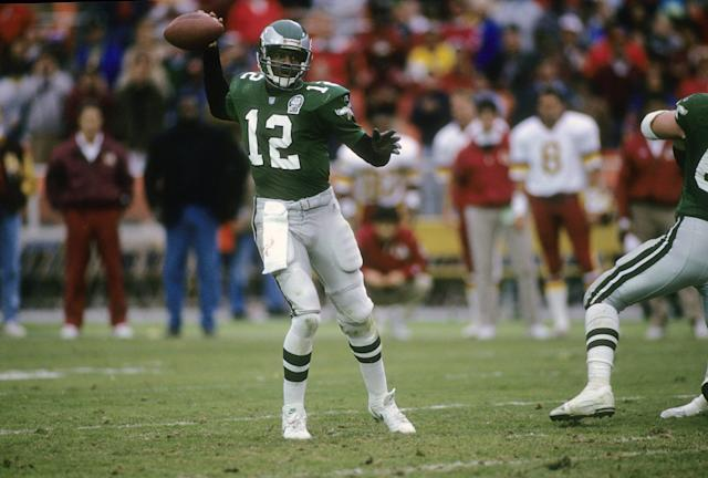 Hard to beat the simple green of Randall Cunningham's jersey here. (Photo by Focus on Sport/Getty Images)