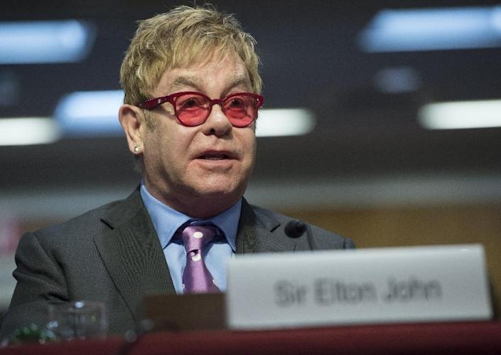 Singer Elton John, founder of the Elton John AIDS Foundation, testifies about global health programs during a Senate Appropriations Subcommittee hearing on Capitol Hill in Washington, DC, May 6, 2015 (AFP Photo/Saul Loeb)