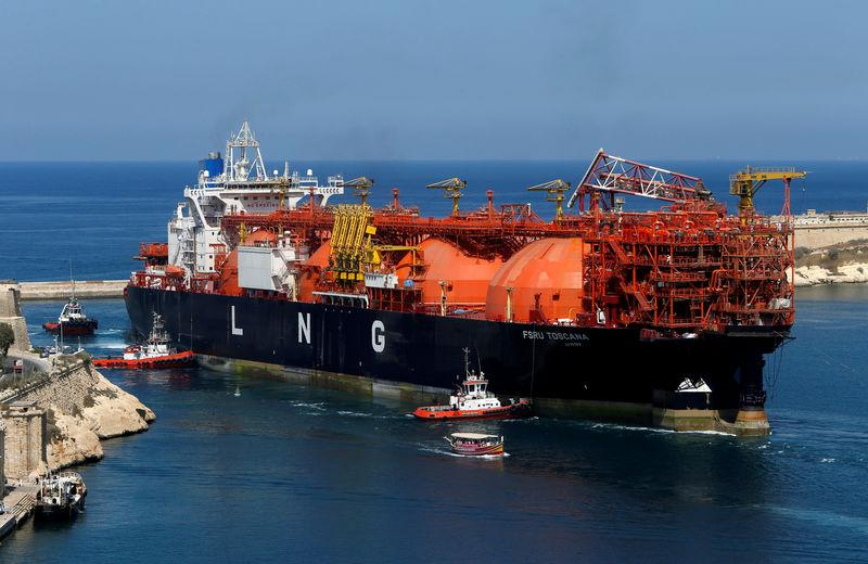 FILE PHOTO: An offshore LNG regasification terminal, the FSRU Toscana, is towed into Valletta's Grand Harbour