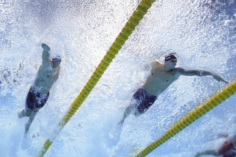 Caeleb Dressel, of the United States, right, swims to win the gold medal in the men's 50-meter freestyle final followed by Florent Manaudou, of France, for silver at the 2020 Summer Olympics, Sunday, Aug. 1, 2021, in Tokyo, Japan. (AP Photo/Jeff Roberson)
