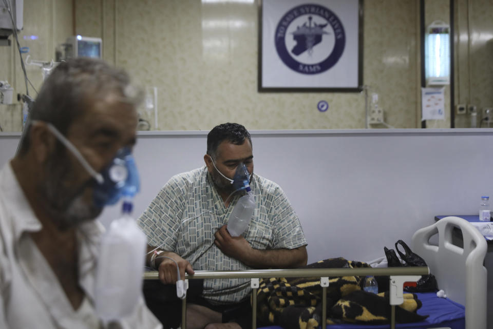 Patients infected with the coronavirus breathe with respirators, in the intensive care unit at the Syrian American Medical Society Hospital, in the city of Idlib, northwest Syria, Monday, Sept. 20, 2021. Coronavirus cases are surging to the worst levels of the pandemic in Idlib province, a rebel stronghold in Syria — a particularly devastating development in a region where scores of hospitals have been bombed and that doctors and nurses have fled in droves during a decade of war. (AP Photo/Ghaith Alsayed)