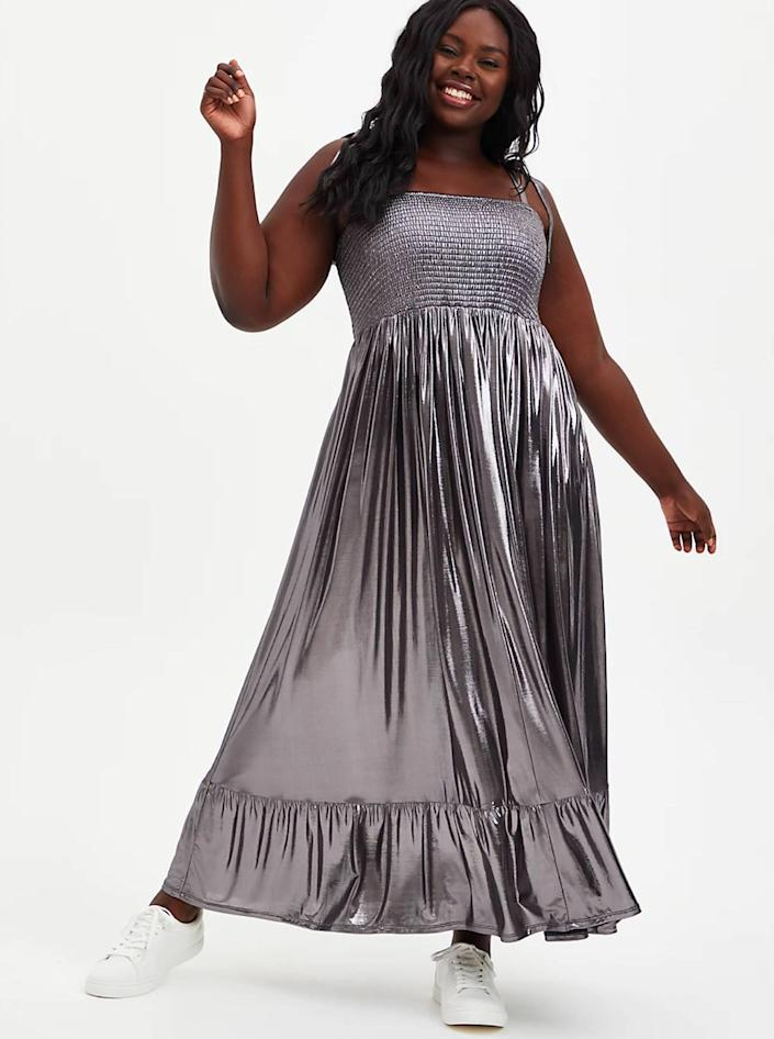 """While this silhouette is relatively casual, the metallic finish takes it to wedding-ready heights. $80, Torrid. <a href=""""https://www.torrid.com/product/grey-metallic-liquid-knit-skater-maxi-dress/14678188.html"""" rel=""""nofollow noopener"""" target=""""_blank"""" data-ylk=""""slk:Get it now!"""" class=""""link rapid-noclick-resp"""">Get it now!</a>"""
