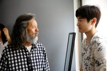 South Korean senior model Kim Chil-doo, 65-years-old, talks with a model during a practice session in Seoul