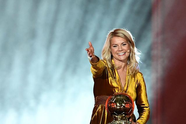 Olympique Lyonnais' Norwegian forward Ada Hegerberg gestures after receiving the inaugural women's Ballon d'Or award for best player of 2018. (Getty)