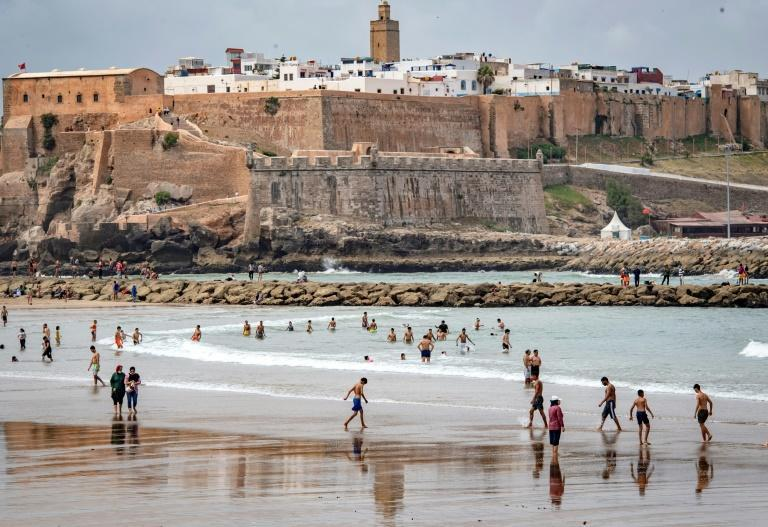 Moroccans gather at a beach north of the capital Rabat last month after authorities eased lockdown measures in some cities