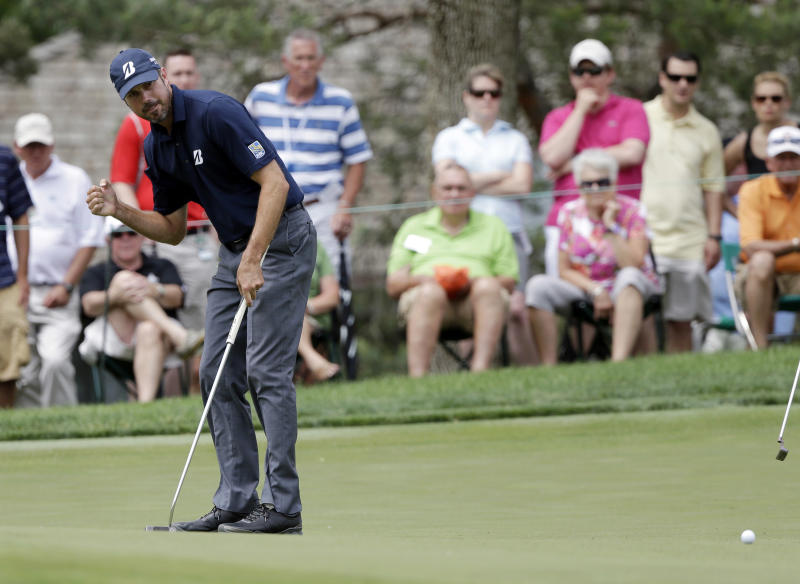 Matt Kuchar reacts after making a birdie on the 10th hole during the third round of the Memorial golf tournament Saturday, June 1, 2013, in Dublin, Ohio. (AP Photo/Darron Cummings)