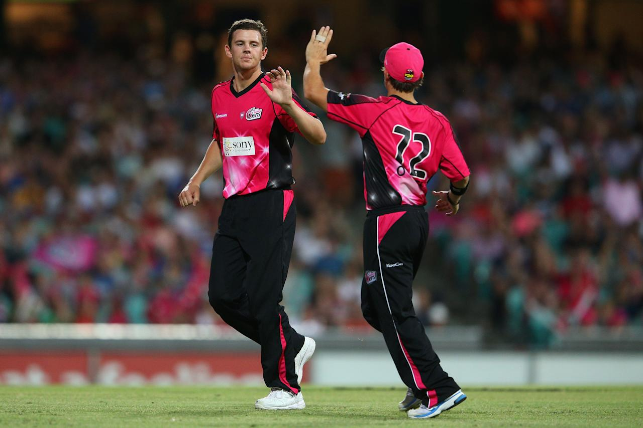 SYDNEY, AUSTRALIA - JANUARY 09: Josh Hazelwood  of the Sixers celebrates with team mate Stephen O'Keefe after dismissing Renegades captain Ben Rohrer during the Big Bash League match between the Sydney Sixers and the Melbourne Renegades at SCG on January 9, 2013 in Sydney, Australia.  (Photo by Cameron Spencer/Getty Images)