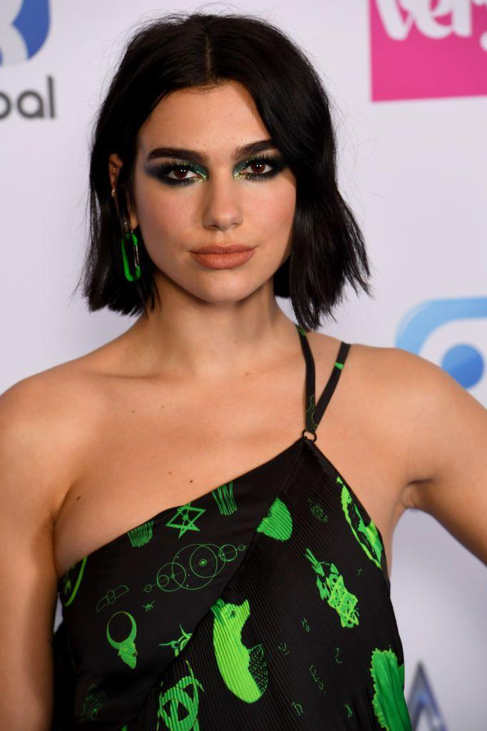 """<p>Though best known for her chunky highlights, Dua Lipa's darker look shown here is easier to maintain—something we'll be seeing a lot more of. """"Due to the pandemic, clients have learned to accept and appreciate their natural color,"""" says Kristina Tabb, a celebrity colorist at <a href=""""https://www.tabbandsparks.com/"""" rel=""""nofollow noopener"""" target=""""_blank"""" data-ylk=""""slk:Tabb & Sparks Salon"""" class=""""link rapid-noclick-resp"""">Tabb & Sparks Salon</a>. And that trend isn't stopping as we approach fall 2021. """"This is easily achieved by matching the base to their natural color to ensure a longer grow out with no lines of demarcation, or going for a more subtle highlight that can last an extra couple of weeks in between services."""" </p>"""
