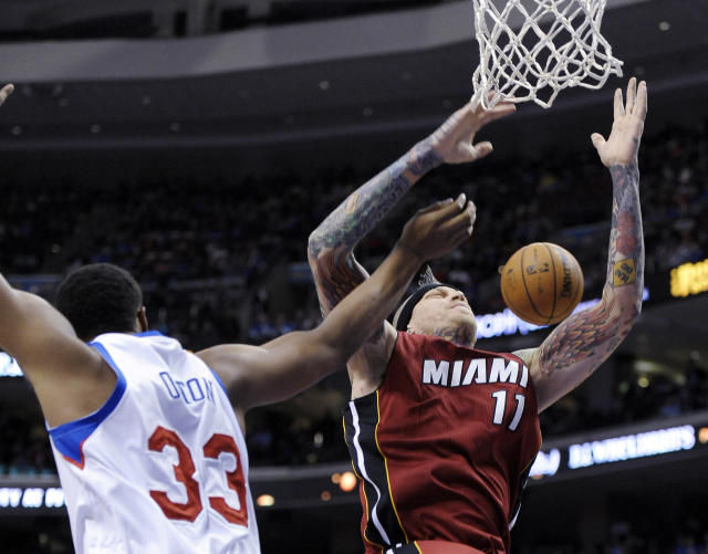 Miami Heat's Chris Anderson (11) reaches for a rebound over Philadelphia 76ers' Daniel Orton during the first half of an NBA basketball game, Wednesday, Oct. 30, 2013, in Philadelphia. (AP Photo/Michael Perez)