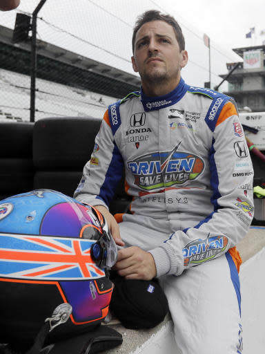 FILE - In this Monday, May 21, 2018, file photo, Stefan Wilson, of England, waits in the pits before a practice session for the IndyCar Indianapolis 500 auto race at Indianapolis Motor Speedway in Indianapolis. Nearly three years after his brother Justin Wilson died at age 37 from injuries sustained when debris from another car hit him in the head at Pocono Raceway, Wilson feels his presence everywhere he turns at Indianapolis Motor Speedway these days. (AP Photo/Darron Cummings File)