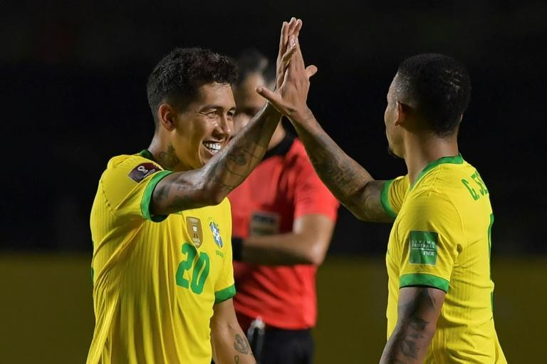Roberto Firmino (L) scored the decisive goal for under-par Brazil in their World Cup South American qualifier against Venezuela