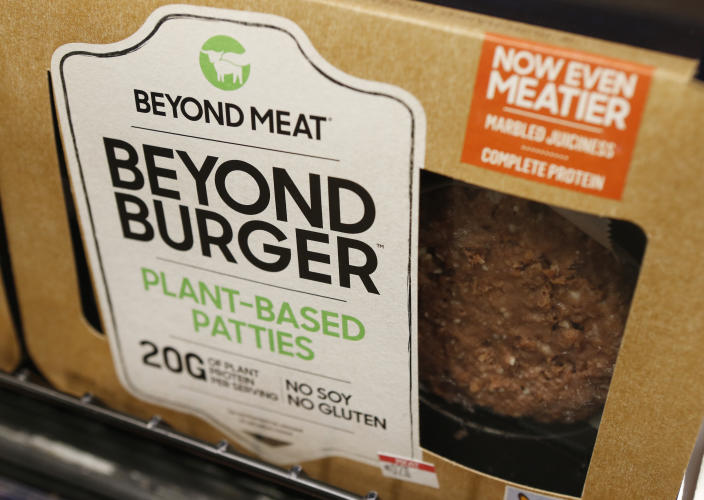 FILE - In this June 27, 2019, file photo a meatless burger patty called Beyond Burger made by Beyond Meat is displayed at a grocery store in Richmond, Va. Shares of Beyond Meat are tumbling in Thursday, Aug. 1,,  premarket trading after the plant-based meat maker priced a secondary stock offering at more than six times its initial public offering opening price. AP Photo/Steve Helber, File)