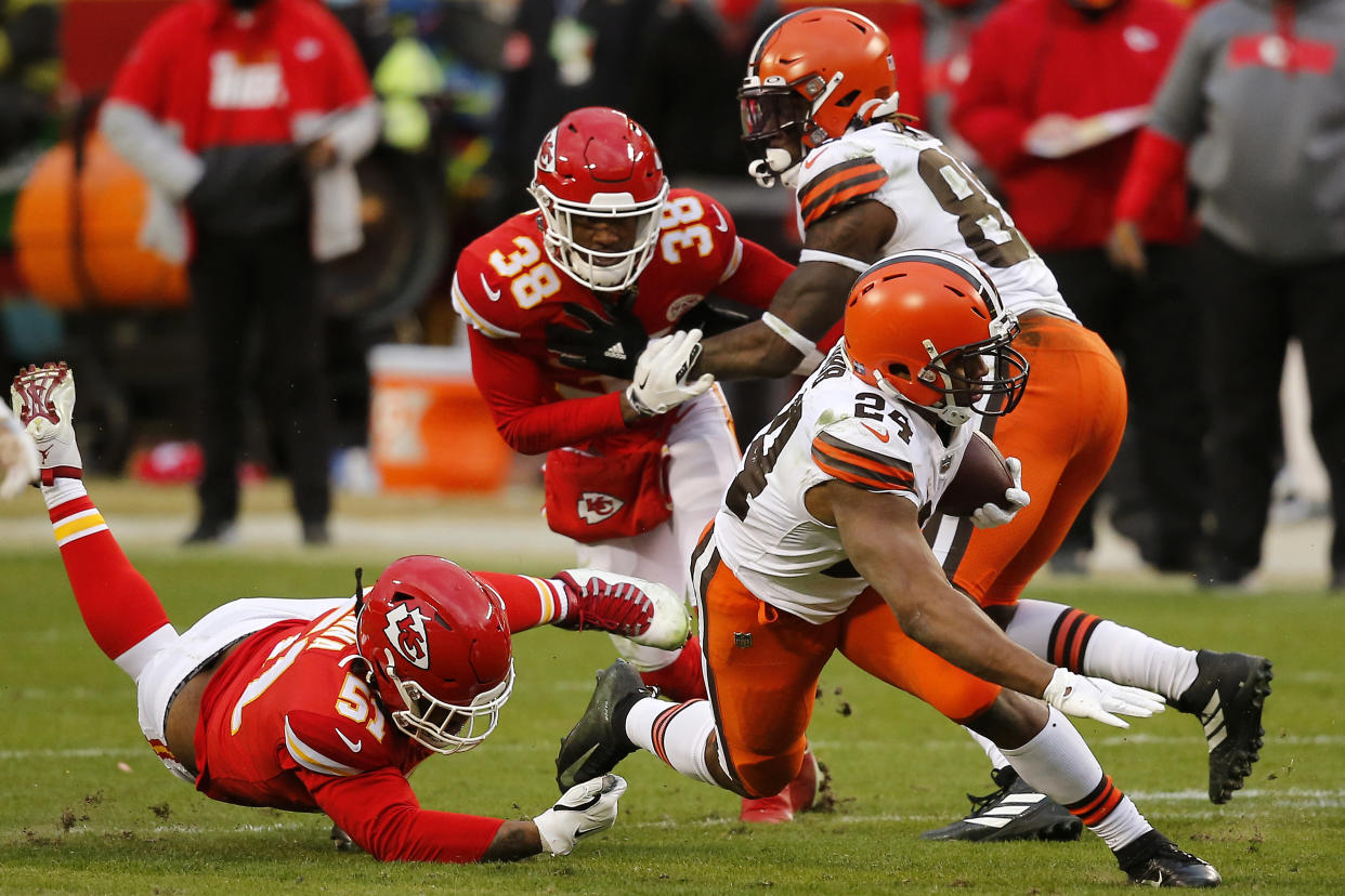 KANSAS CITY, MISSOURI - JANUARY 17: Running back Nick Chubb #24 of the Cleveland Browns is tackled by defensive end Michael Danna #51 of the Kansas City Chiefs during the third quarter of the AFC Divisional Playoff game  at Arrowhead Stadium on January 17, 2021 in Kansas City, Missouri. (Photo by David Eulitt/Getty Images)