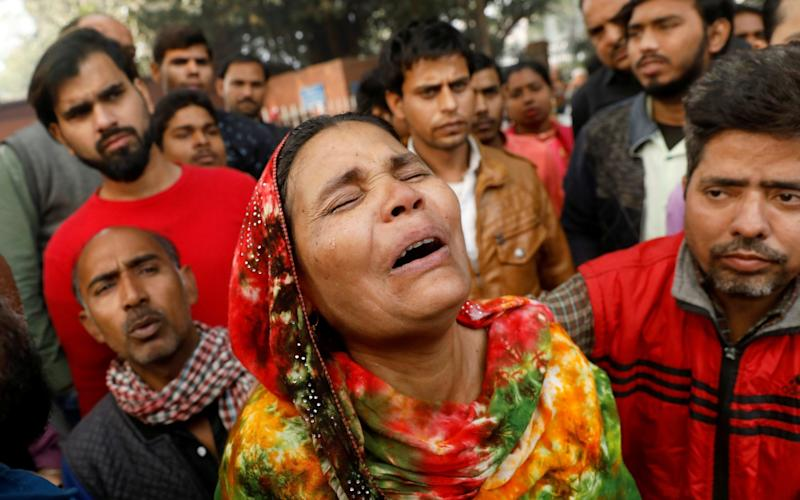 Relatives of the victims gathered outside a hospital mortuary  - REUTERS