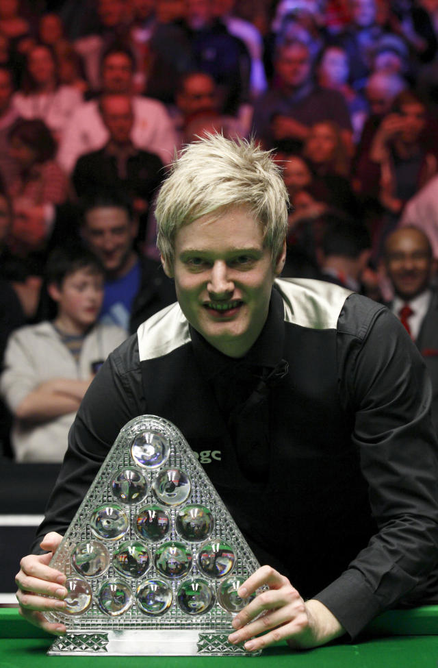 Australia's Neil Roberts poses with the Masters trophy after winning over England's Shaun Murphy in the BGC Masters snooker final at Alexandra Palace in London on January 22, 2012. Australia's 2010 world champion Neil Robertson claimed the Masters title with a 10-6 win over England's Shaun Murphy at Alexandra Palace. AFP PHOTO / JUSTIN TALLIS (Photo credit should read JUSTIN TALLIS/AFP/Getty Images)