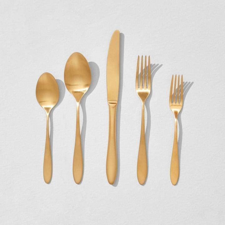 """<h2>Gold Flatware Set</h2><br>Flatware can become quite lackluster in appearance after constant use. Give your arsenal a refresh with these golden pieces. <br><br><strong>rigby home</strong> Gold Flatware Set, $, available at <a href=""""https://go.skimresources.com/?id=30283X879131&url=https%3A%2F%2Frigbyhome.com%2Fproducts%2Fsatin-matte-gold-flatware-setting"""" rel=""""nofollow noopener"""" target=""""_blank"""" data-ylk=""""slk:rigby home"""" class=""""link rapid-noclick-resp"""">rigby home</a>"""